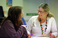 Pictured: An adult is learning how to read and write by a tutor (R) at the Melin Advice Centre in Neath. Monday 24 October 2016<br /> Re: Communities First funding at the MCC Melin Advice Centre in Neath, Wales, UK.