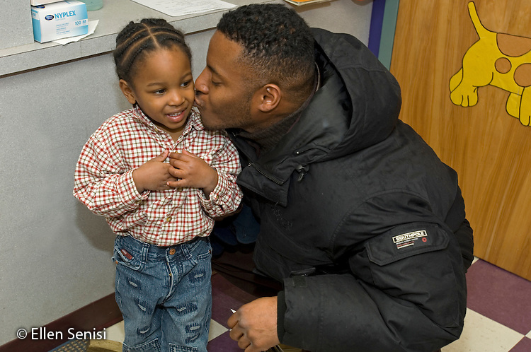 MR / Schenectady, NY.Schenectady Day Nursery / private non-profit daycare center / Toddler class.Father (African-American) kisses his son (2, African-American) goodbye at arrival time..MR: Car21, Car22.© Ellen B. Senisi