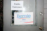 A campaign sign hangs on the door as Vermont senator and Democratic presidential candidate Bernie Sanders speaks at a campaign event at the White Mountain Chalet event hall in Berlin, New Hampshire.