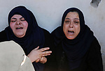 Relatives of 14-year-old Palestinian boy Yasser Abu Al-Naja, who was killed by Israeli troops during clashes in tents protest where Palestinian demand the right to return to their homeland at the Israel-Gaza border, mourn during his funeral in Khan Younis, in the southern Gaza Strip June 30, 2018. Photo by Dawoud Abo Alkas