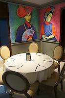 Table and artwork in El Park Bisitro, Mansion Merida hotel, Merida, Yucatan, Mexico...