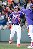 Left fielder Reed Rohlman (26) of the Clemson Tigers in the Reedy River Rivalry game against the South Carolina Gamecocks on Saturday, February 28, 2015, at Fluor Field at the West End in Greenville, South Carolina. South Carolina won, 4-1. (Tom Priddy/Four Seam Images)
