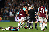 Paul Pogba of Manchester United and Andy Carroll of West Ham United square up during West Ham United vs Manchester United, Premier League Football at The London Stadium on 10th May 2018