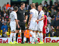 Referee Robert Jones is surrounded by Leeds United players after the final whistle<br /> <br /> Leeds United's Liam Cooper<br /> <br /> Photographer Alex Dodd/CameraSport<br /> <br /> The EFL Sky Bet Championship - Leeds United v Nottingham Forest - Saturday 10th August 2019 - Elland Road - Leeds<br /> <br /> World Copyright © 2019 CameraSport. All rights reserved. 43 Linden Ave. Countesthorpe. Leicester. England. LE8 5PG - Tel: +44 (0) 116 277 4147 - admin@camerasport.com - www.camerasport.com