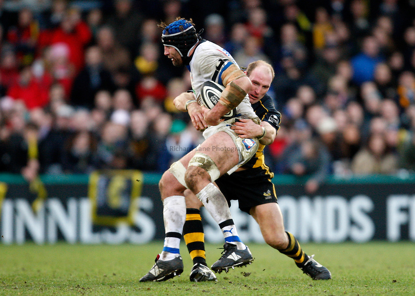 Photo: Richard Lane/Richard Lane Photography..London Wasps v Bath Rugby. Guinness Premiership. 29/12/2007. .Bath's Danny Grewcock is tackled by Wasps' Lawrence Dallaglio.