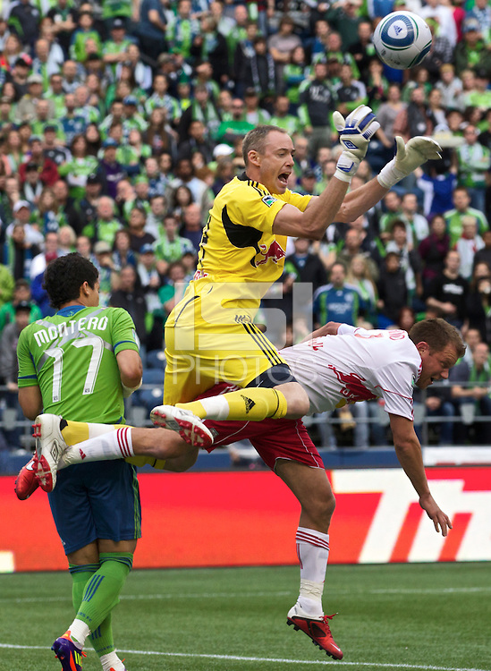 New York Red Bulls goalkeeper Greg Sutton makes a pay on the ball as he collides with teammate New York Red Bulls midfielder Teemu Tainio during play against the Seattle Sounders FC at Qwest Field in Seattle Saturday June 23, 2011. The Sounders won the game 4-2.