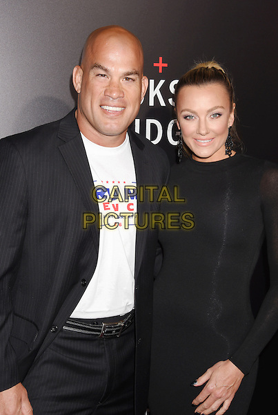 BEVERLY HILLS, CA - OCTOBER 24: MMA fighter Tito Ortiz (L) and model Amber Nichole Miller attend the screening of Summit Entertainment's 'Hacksaw Ridge' at Samuel Goldwyn Theater on October 24, 2016 in Beverly Hills, California.<br /> CAP/ROT/TM<br /> &copy;TM/ROT/Capital Pictures