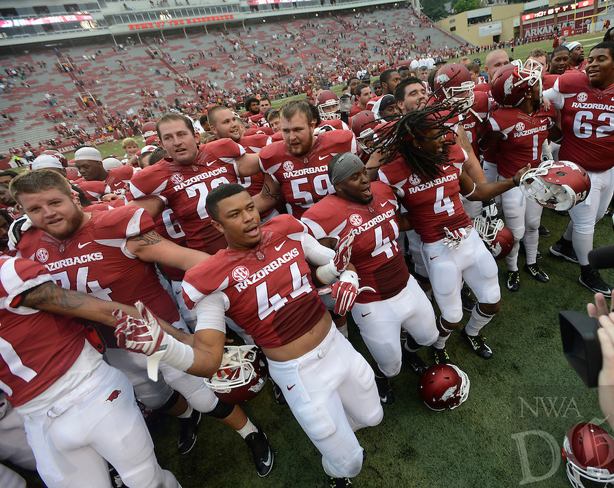 STAFF PHOTO ANTHONY REYES • @NWATONYR<br /> Members of the Razorbacks celebrate a win against Nicholls State in the fourth quarter Saturday, Sept. 6, 2014 at Razorback Stadium in Fayetteville. The Hogs won 73-7.