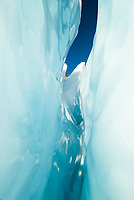 Beautiful shape of blue crevasse on Franz Josef Glacier, Westland Tai Poutini National Park, UNESCO World Heritage Area, West Coast, New Zealand, NZ