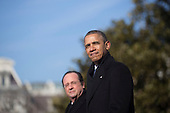 United States President Barack Obama, right, and President Francois Hollande of France stand during an arrival ceremony on the South Lawn of the White House in Washington, D.C., U.S., on Tuesday, Feb. 11, 2014. <br /> Credit: Andrew Harrer / Pool via CNP