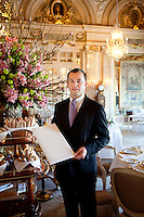 Pierre, Maitre d'Hotel, poses for the photographer with a menu in the dining room of the Louis XV restaurant at the Hotel de Paris, Monte Carlo, Monaco, 21 March 2013