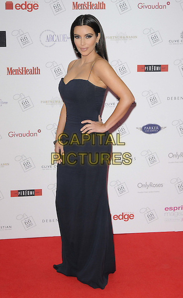 Kim Kardashian.The FiFi UK Fragrance Awards 2012 at The Brewery, Chiswell Street, London, England..May 17th 2012.full length blue black dress maxi hand on hip side .CAP/CAN.©Can Nguyen/Capital Pictures.