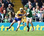 Conor McGrath of Clare in action against Sean Finn of Limerick during their Munster Championship semi-final at Thurles.  Photograph by John Kelly.