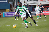 17th March 2019, Dens Park, Dundee, Scotland; Ladbrokes Premiership football, Dundee versus Celtic; Odsonne Edouard of Celtic goes past Genserix Kusunga of Dundee