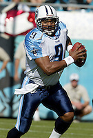 Tennessee Titans quarterback Steve McNair scrambles  during a game against the Jacksonville Jaguars in Jacksonville, FL on Sunday, December 22, 2002.  Tennessee won the game 28 to 10. (Photo by Brian Cleary/www.bcpix.com)