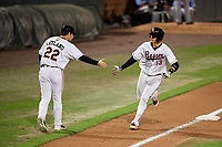 Bowie Baysox catcher Martin Cervenka (13) is congratulated by bench coach Pat Leyland (22) as he rounds third base after hitting a home run in the bottom of the fifth inning during the second game of a doubleheader against the Trenton Thunder on June 13, 2018 at Prince George's Stadium in Bowie, Maryland.  Bowie defeated Trenton 10-1.  (Mike Janes/Four Seam Images)