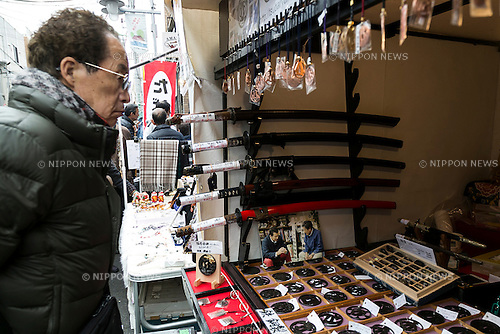 Traditional Japanese swords on sale during the annual Setagaya Boroichi flea market on December 15, 2015, Tokyo, Japan. Thousands of shoppers visit the market which runs for two days twice a year, along the Boroichi Dori in Setagaya. Around 700 stall holders participate in the market which has been held for more than 400 years. (Photo by Rodrigo Reyes Marin/AFLO)