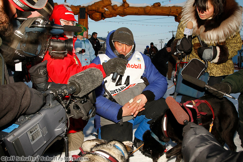 John Baker gets inundated with media after finishing in 3rd place.    Iditarod 2009