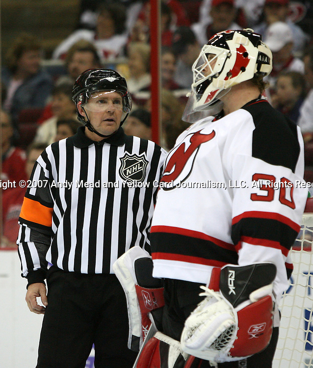 Referee Kerry Fraser (l) chats with New Jersey's Martin Brodeur (30) during a timeout on Thursday, March 15, 2007 at the RBC Center in Raleigh, North Carolina. The New Jersey Devils defeated the Carolina Hurricanes 3-2 in a regular season National Hockey League game.