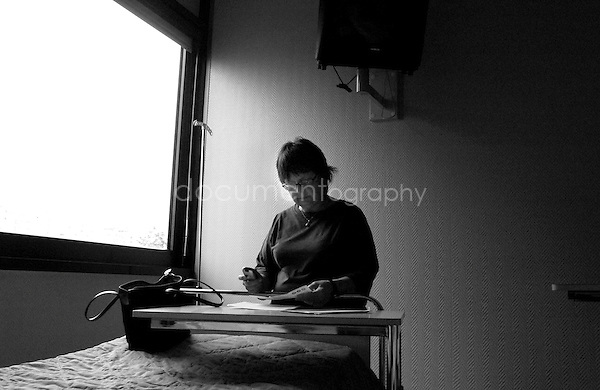My mother after that my grandmother has been injured, she is waiting for my grandmother to wake up for her recent surgery. ..© Magali Corouge/Documentography.2004-2006.France