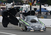Aug. 3, 2013; Kent, WA, USA: NHRA funny car driver Alexis DeJoria during qualifying for the Northwest Nationals at Pacific Raceways. Mandatory Credit: Mark J. Rebilas-USA TODAY Sports