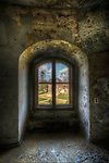 An abandoned palace in East Germany with arched window