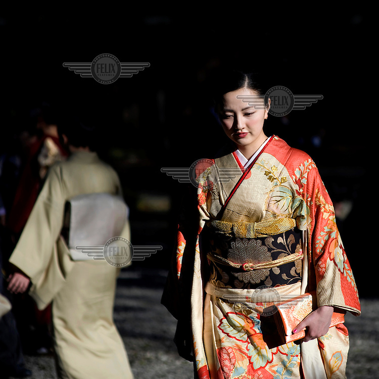 A woman, dressed in an ornate Kimono, attends a Shinto wedding at the Meiji Jingu Shinto Shrine. /Felix Features