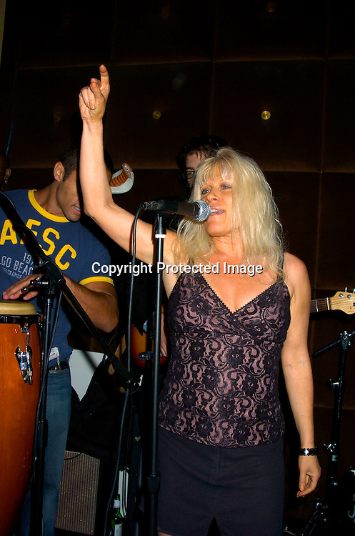 Ilene Kristen singing ..at Prohibition Night Club  for the Gabriel Project Benefit on June 5, 2004 in New York Citiy. The Gabriel Project provides heart surgery for children from developing countries.                                                                                Photo by Robin Platzer, Twin Images