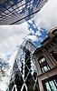 An upward view of the Gherkin building, London, with other buildings in shot.