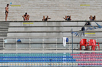 Mattia Zuin, Alessio Proietti Colonna, Marco De Tullio, Stefano Di Cola and Gabriele Detti, warm up, respecting the social distancing, before the start of a training session. Some adhesive stripes reading ' respect the safety distance ' have been put on the wall and on the steps to comply the security measures decided by italian swimming federation . <br /> Italian athletes were able to resume training last week after more than 50 days of lockdown due to the coronavirus (covid-19) pandemic <br /> Roma 12-5-2020 Centro Federale di Ostia <br /> Photo Andrea Staccioli / Deepbluemedia / Insidefoto