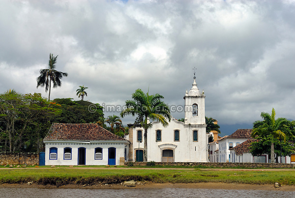 The church Igreja Nossa Senhora das Dores in the historic centre of Paraty, Espirito Santo, Brazil. --- Info: The beautiful colonial town of Paraty has been a UNESCO World Heritage Site since 1958. Very charming the whitewashed churches and terra-cotta roofs contrast the lush green of the rainforest-clad mountains.  --- No signed releases available.