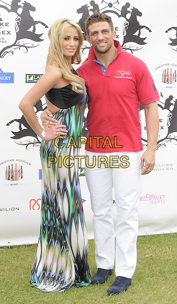 Chantelle Houghton & Alex Reid .The Duke of Essex Polo Trophy at Gaynes Park, Epping, England, UK,.July 9th 2011..full length long maxi green black print dress red top shirt white trousers blue couple arm around   .CAP/CAN.©Can Nguyen/Capital Pictures.