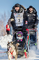 Otto Balogh and team run past spectators and down the Cordova Street hill with an Iditarider in the basket and a handler during the Anchorage, Alaska ceremonial start on Saturday March 4th during the 2017 Iditarod race. Photo ©2017 by Daniel Lent/SchultzPhoto.com