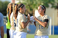 21 August 2011:  FIU's Victoria Miliucci (18) high-fives with teammates prior to the match.  The University of Florida Gators defeated the FIU Golden Panthers, 2-0, at University Park Stadium in Miami, Florida.