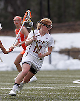 Boston College defender Kara O'Connell (10) brings the ball forward.   Syracuse University (orange) defeated Boston College (white), 17-12, on the Newton Campus Lacrosse Field at Boston College, on March 27, 2013.