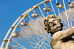 Statue in The Tuileries Gardens with Ferris Wheel in Background. Paris, France