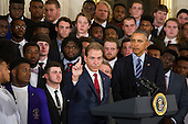 United States President Barack Obama (right) looks on while Alabama Head Coach Nick Saban (left) offers remarks during a ceremony to honor the 2015- 2016 College Football Playoff National Champion Alabama Crimson Tide in the East Room at The White House in Washington, D.C., Wednesday, March 2, 2016. <br /> Credit: Rod Lamkey Jr. / Pool via CNP