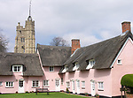 A4TR7E Pink cottages and church Cavendish Suffolk England