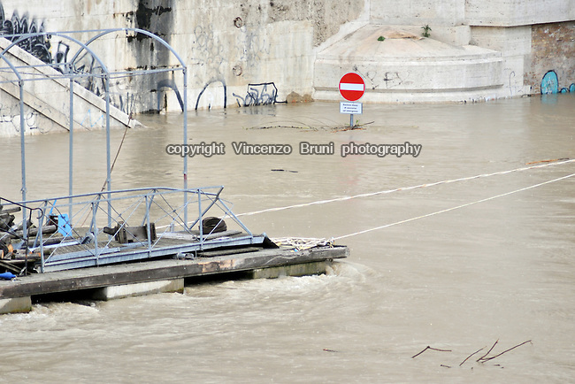 Rome, Italy - May 17, 2010 Due to massive rains in few hours, the river Tiber grows to a pretty concerning high level of water, almost covering street signals along the banks.