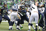 Seattle Seahawks safety Kelcie McCray (33) stops St. Louis Rams running back Todd Gurley (30) at CenturyLink Field in Seattle, Washington on December 27, 2015.  The Rams beat the Seahawks 23-17.      ©2015. Jim Bryant Photo. All Rights Reserved