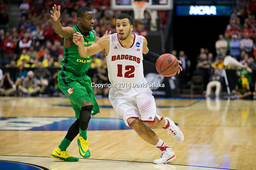 Wisconsin Badgers guard Traevon Jackson (12) draws a foul during the third-round game in the NCAA college basketball tournament against the Oregon Ducks Saturday, April 22, 2014 in Milwaukee. The Badgers won 85-77. (Photo by David Stluka)