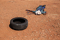 A man lies dead after being shot (allegedly) by the Red Ants during a so-called 'demolition' operation to clear dwellings and evict squatters from land in Vlakfontein. The violent action resulted in the deaths of two people from among the community being evicted. The Red Ants are a controversial private security company often hired to clear squatters from land and so-called 'hijacked' properties.