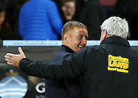 Swansea City manager Garry Monk with counterpart Steve Bruce of Hull City during the Capital One Cup match between Hull City and Swansea City played at the Kingston Communications Stadium, Hull