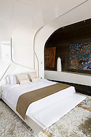 One of two bedrooms in the Villa Bianca at Iniala are designed by the Spanish practice A-Cero to resemble giant seashells