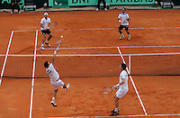 Britain's Ross Hutchins returns the Ball  during their Davis Cup quarter-final doubles tennis match against Italy's in Naples April 5, 2014.