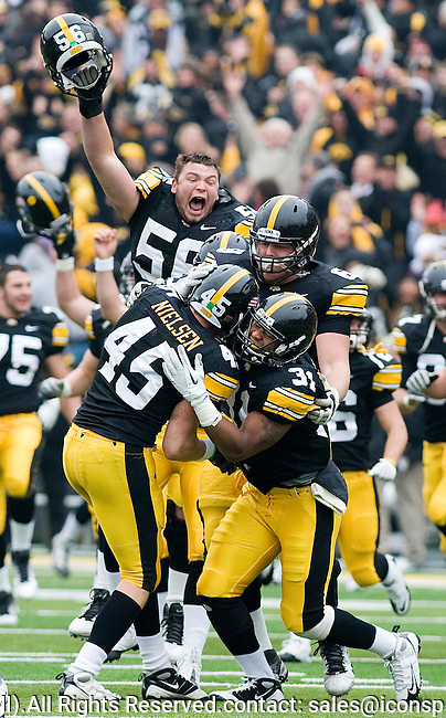 Saturday, November 5, 2011. Iowa players erupt off the bench to celebrate their 24-16 win over Michigan after stopping the Wolverines on four consecutive plays inside the 10-yard line at the end of the game at Iowa's  Kinnick Stadium in Iowa City.