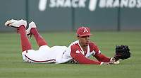 NWA Democrat-Gazette/ANDY SHUPE<br /> Arkansas left fielder Christian Franklin misplays a ball hit Friday, March 15, 2019, during the third inning against Missouri at Baum-Walker Stadium in Fayetteville. Visit nwadg.com/photos to see more photographs from the game.