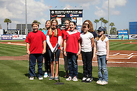 New York Mets have local youths sing the national anthem before an exhibition game vs the Michigan Wolverines at Digital Domain Ballpark in Port St. Lucie, Florida;  February 27, 2011.  New York defeated Michigan 7-1.  Photo By Mike Janes/Four Seam Images