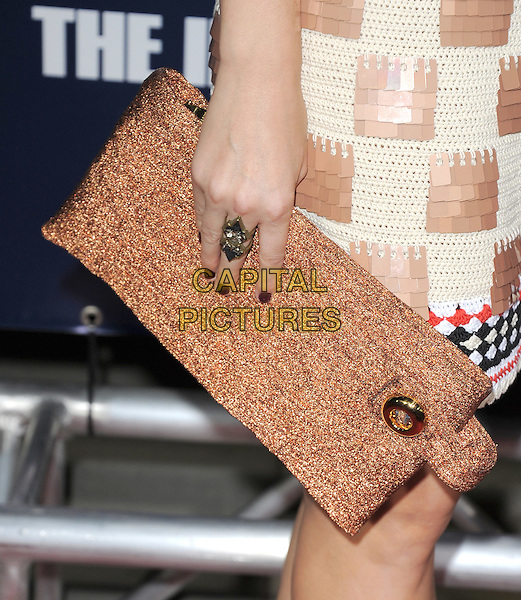 Kate Mara's bag.The L.A. Premiere of 'The Ides of March' held at The Academy of Motion Picture Arts & Sciences  in Beverly Hills, California, USA..September 27th, 2011.hand clutch silver ring red nail varnish polish white beige paillettes sequins sequined dress check brown clutch bag detail .CAP/RKE/DVS.©DVS/RockinExposures/Capital Pictures.
