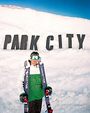USA, Utah, pro skier John Symms standing under gap jump, Park City Ski Area